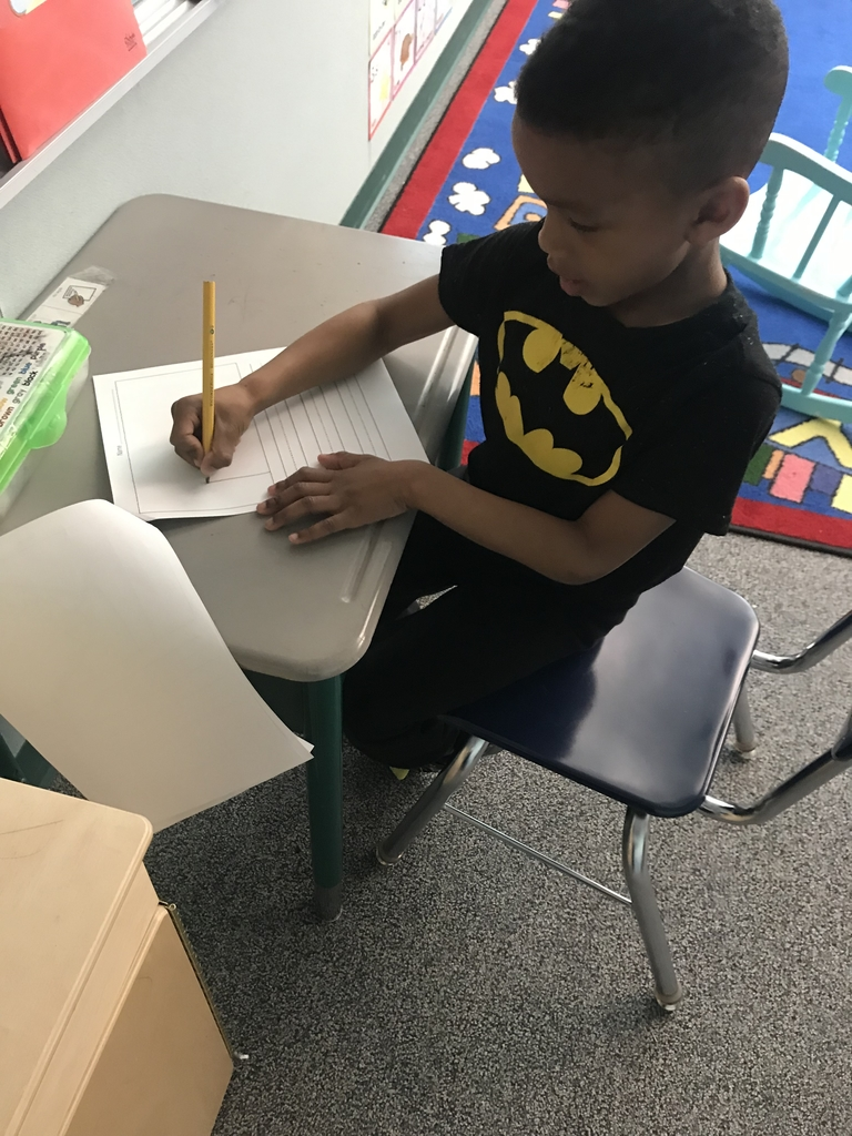 Kindergartener writing.