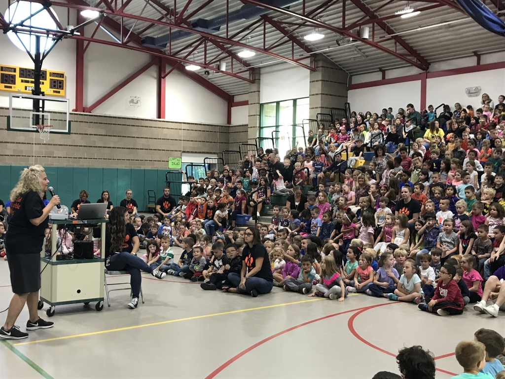 Students participate in an assembly